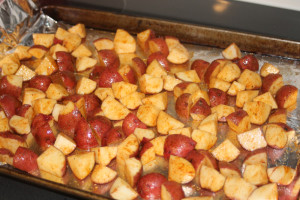 Toss the potatoes in olive oil and spices.